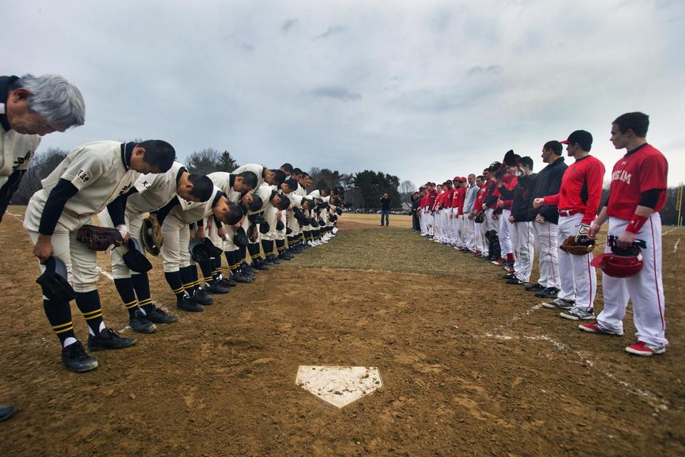 Members of the Tennoji team bowed to their opponents before the teams' scrimmage.